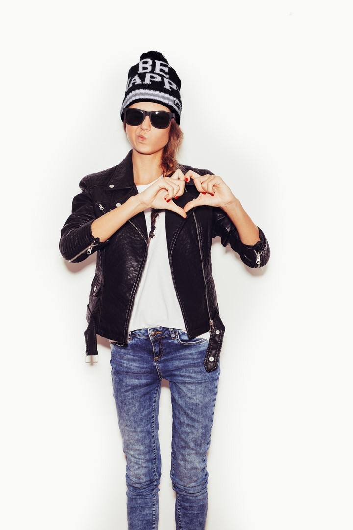 Girl in sunglasses Forming a Heart with Her Hands