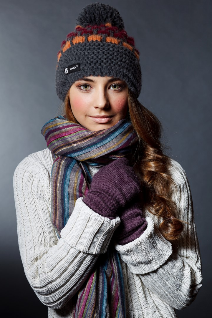 Beautiful girl in winter clothes. Studio shot