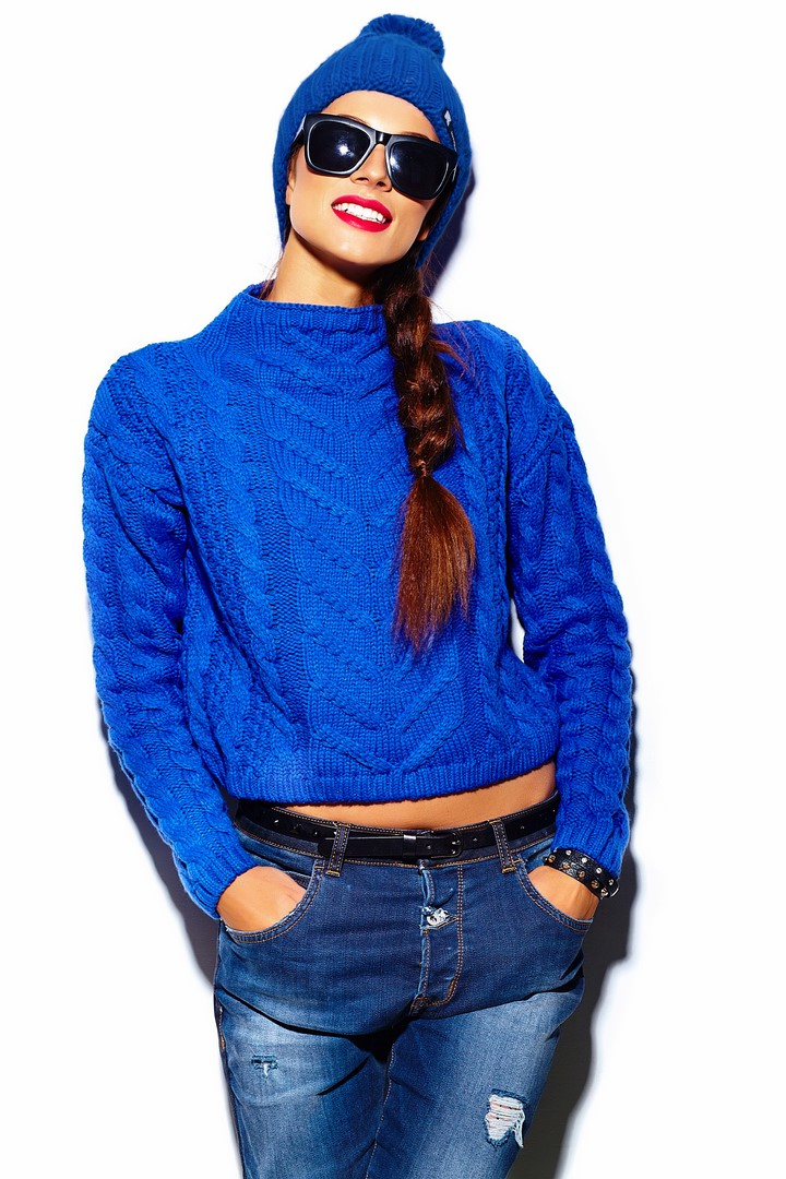 High fashion look.glamor stylish beautiful  young woman model with red lips  in blue sweater hipster cloth in beanie